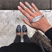 jewels,silver ring,wings ring,knuckle ring,jewelry,leather purse,bag,hipster wishlist,nail accessories,boho jewelry,shoes,feathers,bracelets,hand jewelry,ring,leaves,plume,amazin,black,black shoes,jewerly,silver,leaf ring,leaf bracelet,silver jewelry,hand chain,ring bracelet cool trend,hand
