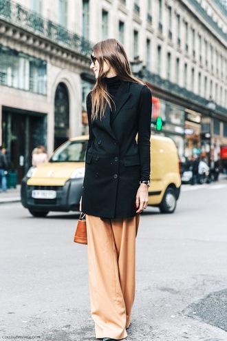 le fashion image blogger jacket bag jewels coat tumblr black coat sunglasses streetstyle pants peach wide-leg pants brown bag top black top turtleneck black turtleneck top