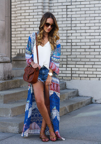 twenties girl style blogger jacket tank top shoes sunglasses bag jewels kimono long coat printed coat white top brown bag crossbody bag denim shorts shorts blue shorts watch tortoise shell tortoise shell sunglasses summer outfits sandals flat sandals