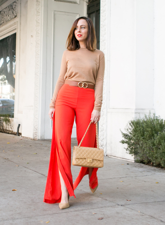 sydne summer's fashion reviews & style tips blogger sweater belt pants bag jewels shoes make-up red pants slit pants chanel bag nude sweater