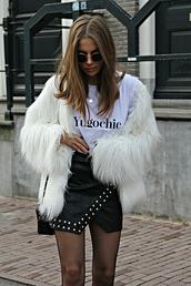 jacket,tumblr,fur jacket,faux fur jacket,white fur jacket,skirt,mini skirt,asymmetrical,asymmetrical skirt,studded,leather skirt,black leather skirt,t-shirt,white t-shirt,quote on it,tights,net tights,fishnet tights,sunglasses