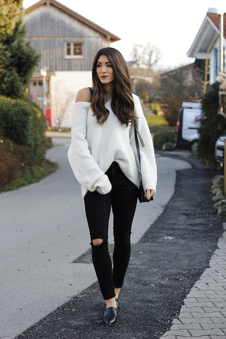 seekingsunshine blogger sweater jeans shoes make-up bag white sweater black pants loafers winter outfits