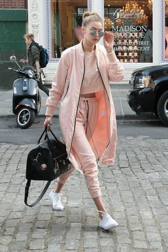 pants pink pants pink top crop tops sneakers white sneakers coat pink coat bag black bag sunglasses dior mirrored sunglasses gigi hadid celebrity style celebrity