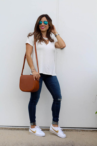 t-shirt cut-out t-shirt denim skinny jeans nike white sneakers blogger blogger style shoulder bag nike cortez