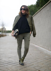 lovely pepa,blogger,khaki pants,quilted,bomber jacket,studded shoes,jacket,pants,shoes,sweater,bag,jewels,sunglasses,army green jacket,khaki bomber jacket,satin bomber,streetwear,khaki,printed boots,printed ankle boots