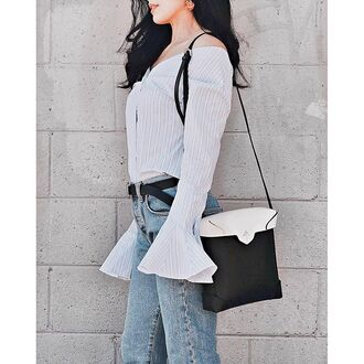 top tumblr white shirt off the shoulder off the shoulder top bell sleeves bag black and white stripes striped shirt jeans denim blue jeans belt stripe shirt