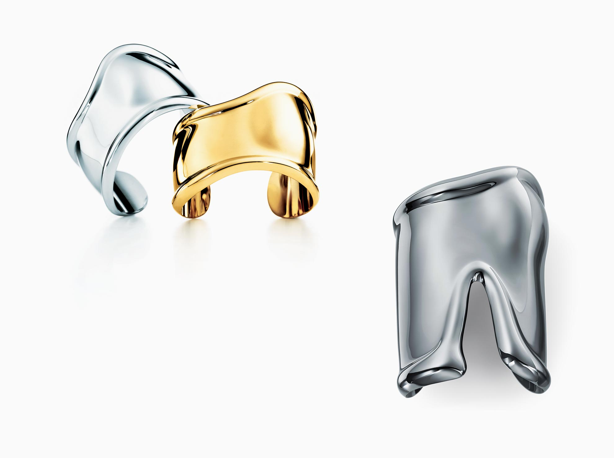 Elsa Peretti® charcoal-color Bone cuff in ruthenium, small, right wrist.              