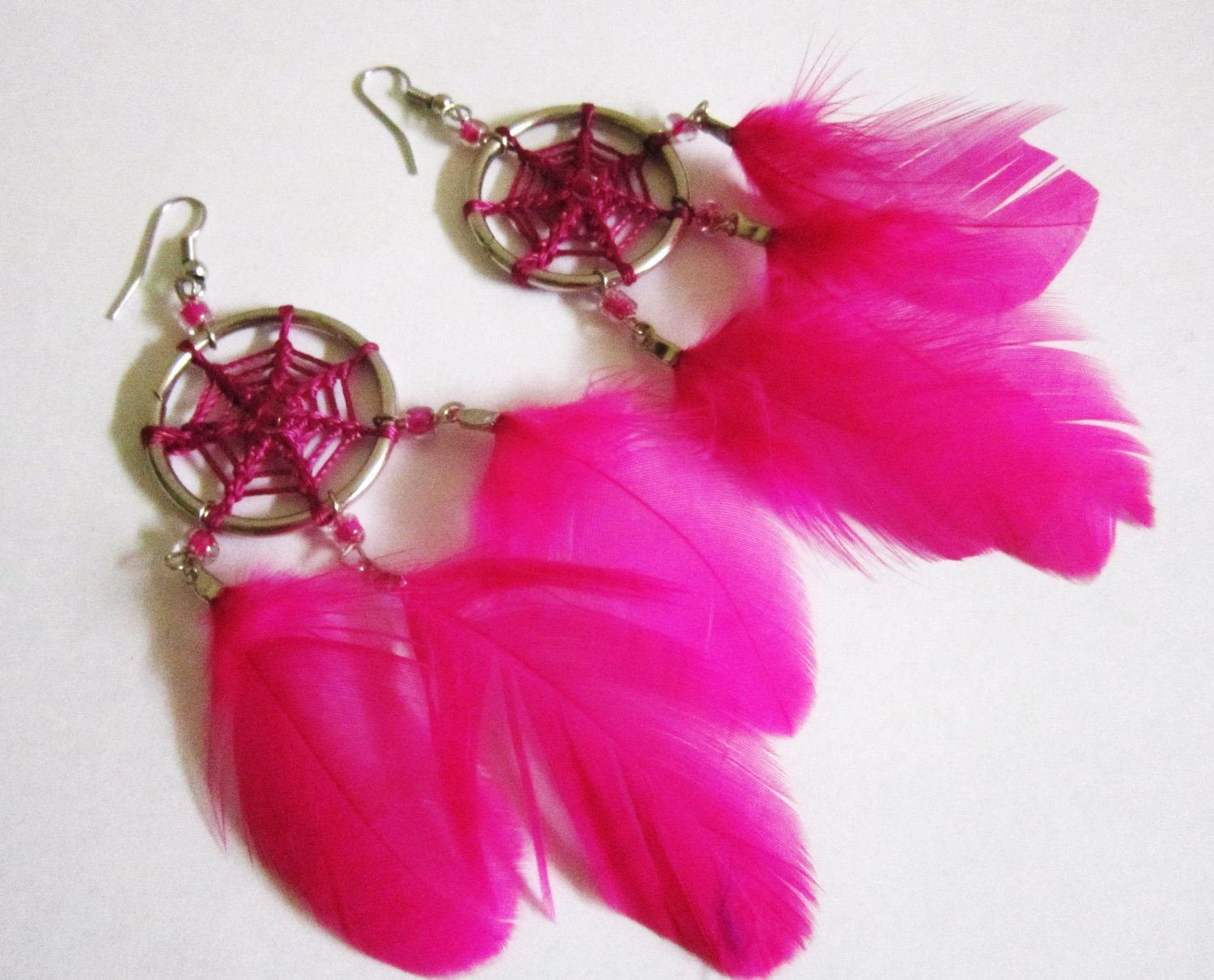 Amazon.com: wholesale lot 12 pairs dream catcher feathers earrings from peru: musical instruments