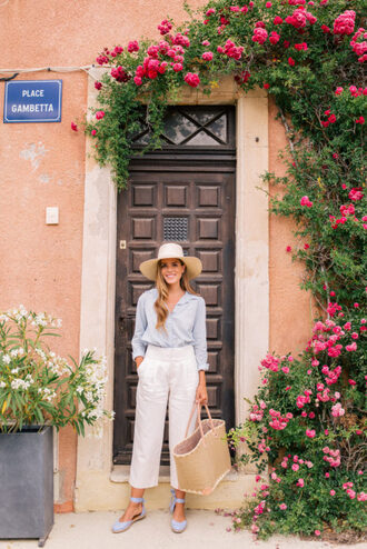 gal meets glam blogger top pants shoes hat bag espadrilles summer outfits white pants basket bag blue shirt summer hat