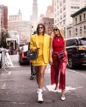 skirt,mini skirt,yellow skirt,white sneakers,blazer,turtleneck,wide-leg pants,cropped pants,sleeveless top,sunglasses,earrings,chain necklace,belt bag,handbag
