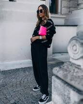 sweater,knitted sweater,balenciaga,sneakers,pants,black pants,clutch,sunglasses,round sunglasses