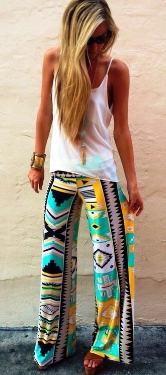 pants top with egyptisk print aztec tribal pattern pattern lounge pants flowy pants colourful teal yellow pants aztec pattern colourful yellow aqua pretty print colour mint aztec leggings colorful pants