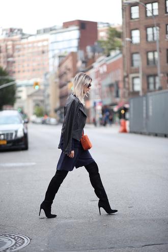 the fashion guitar blogger jacket bag sunglasses high boots navy orange