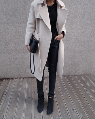 coat creme colored trench coat leather pants all black everything fashion long coat nude nude coat creme bag mini bag handbag belt beige creme jacket pea coat warm nice winter outfits jacket winter coat fall outfits petticoat wool outerwear cream pants leggings boots