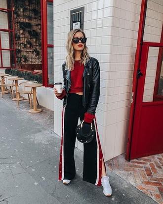 pants black pants red sweater black jacket wide-leg pants sweatpants sweater jacket sunglasses sneakers white sneakers