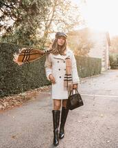 coat,teddy bear coat,scarf,checkered,cap,handbag,leather bag,knee high boots,black boots