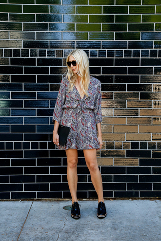 modern ensemble blogger dress shoes bag sunglasses jewels long sleeves mini dress v neck dress clutch black sneakers sneakers three-quarter sleeves short dress printed dress black sunglasses pouch black shoes spring outfits