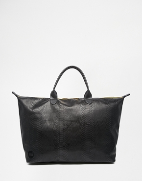 Pac Weekend Bag in Faux Snake Print at asos.com