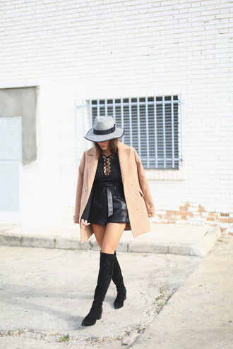seams for a desire blogger lace up top leather shorts flat boots suede boots camel coat lace up bodysuit bodysuit black bodysuit hat black shorts over the knee boots black boots long sleeve bodysuit