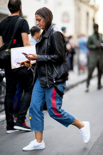 jeans fashion week street style fashion week 2016 fashion week paris fashion week 2016 cropped jeans sneakers white sneakers low top sneakers nike nike shoes black leather jacket leather jacket black jacket jacket streetstyle fall outfits