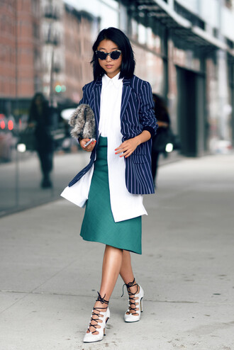 shine by three blogger jacket skirt bag sunglasses shoes printed blazer white shirt asymmetrical asymmetrical skirt midi skirt lace up heels white heels high heels furry pouch pouch cat eye office outfits work outfits furry bag