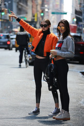 jacket,bomber jacket,athleisure,cropped sweater,grey sweater,tommy hilfiger,orange,celebrity,celebrity style,gigi hadid,bella hadid,black leggings,sporty chic,sunglasses,hadid sister,capri pant,crops tops,fashion jacket,fashionable leggings,round sunglasses,bag,orange jacket,orange bomber jacket,crop tops,black crop top,turtleneck,black turtleneck crop top,black turtleneck top,leggings,sports leggings,sneakers,high top converse,converse sneakers,grey crop top,grey crop hoodie,tommy hilfiger crop top,black sunglasses,mirrored sunglasses,black bag,grey sneakers,streetstyle,sportswear,gigi hadid bomber jacket,Celeb Gym Clothes,gigi hadid Gym Clothes,bella hadid gym clothes,shoes,black sweater,hadid sisters,Gigi Hadid Leggings