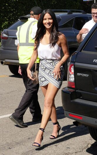 skirt sandals tank top summer outfits summer olivia munn white tank top mini skirt asymmetrical skirt asymmetrical sandal heels