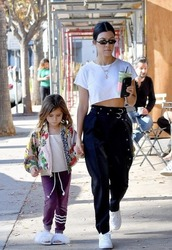 pants,crop tops,black and white,sneakers,kourtney kardashian,kardashians,streetstyle,fall outfits,top