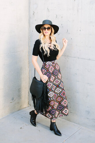a little dash of darling blogger top skirt bag shoes hat sunglasses black top lace up top black hat shoulder bag fringes fringed bag maxi skirt black boots ankle boots