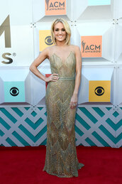 dress,gold,gown,prom dress,wedding dress,carrie underwood,long prom dress,red carpet,see through dress,see through
