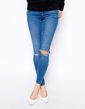 ASOS   ASOS Ridley High Waist Ultra Skinny Jeans In Busted Mid Wash Blue with Busted Knees at ASOS