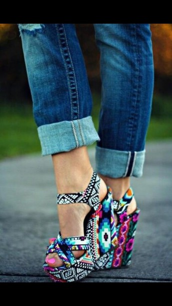 shoes where do i get these shoes multicolor wedges aztec print shoes tribal pattern steve madden high heels colorful shoes colorful wedges colorful aztec wedges heels aztec tribal shoes wedge sandals tribal pattern heels vibrant colors aztec heels tribal bright colored wedges cute high heels