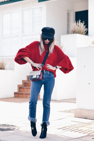 sweater tumblr red sweater bell sleeves bell sleeve sweater denim jeans blue jeans frayed denim frayed jeans boots black boots zip bag crossbody bag hat fisherman cap sunglasses