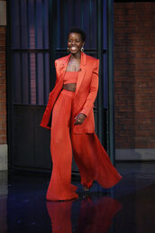 pants,top,jacket,blazer,red,pleated,bandeau,crop tops,lupita nyong'o,earrings,spring outfits,red pants,red outfit,wide-leg pants