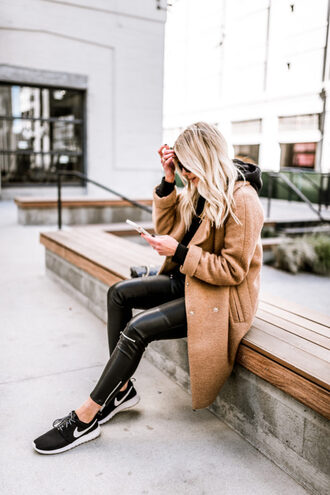 coat tumblr camel camel coat pants black pants black leather pants leather pants zipped pants sneakers black sneakers nike nike shoes nike running shoes blonde hair