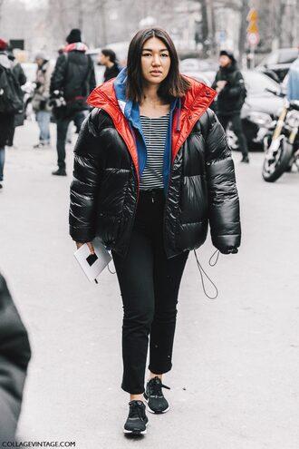 jacket tumblr fashion week 2017 streetstyle black jacket down jacket puffer jacket oversized jacket oversized sports jacket top striped top stripes denim jeans black jeans sneakers black sneakers