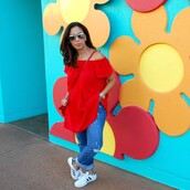 top,red off shoulder top,red top,off the shoulder,off the shoulder top,crossbody bag,bag,red bag,denim,jeans,blue jeans,ripped jeans,cuffed jeans,sneakers,low top sneakers,white shirt,white sneakers,adidas superstars,adidas,adidas shoes,sunglasses,mirrored sunglasses