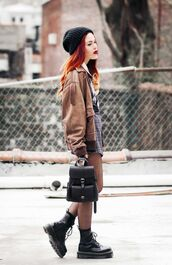 shoes,brown jacket,black beanie,grey sweater,black backpack,combat boots,blogger