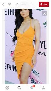 dress,orange dress,kylie jenner,wrap dress,yellow dress,v neck,v neck dress