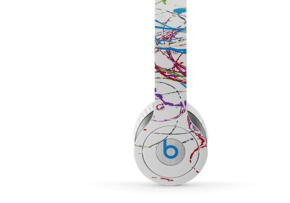 colorful paint splatter technology headphones