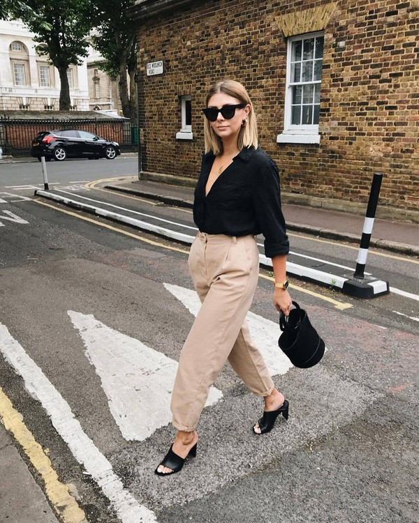 pants top black top sunglasses bag