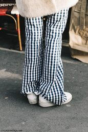 pants,tumblr,fashion week 2017,streetstyle,checkered,sneakers,white sneakers,printed pants,flare pants