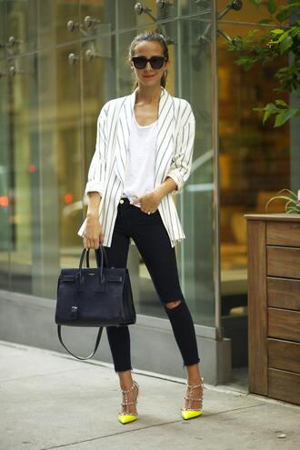something navy bag shoes jacket t-shirt jeans sunglasses jewels pants yellow neon yellow heels yellow pumps pointed toe pointed toe pumps high heels