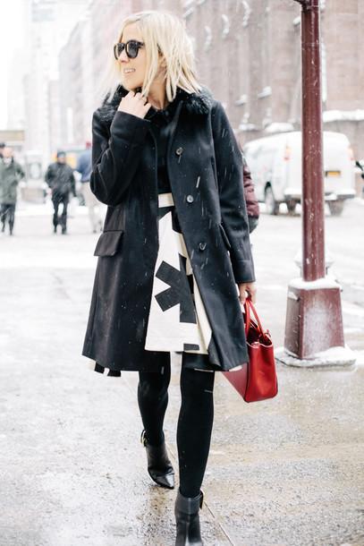 damsel in dior blogger black coat high waisted skirt red bag