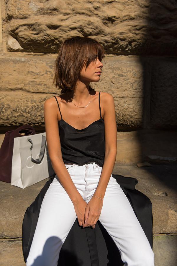 thepetticoat blogger top coat jeans shoes bag black cami top cami top black top blue jeans