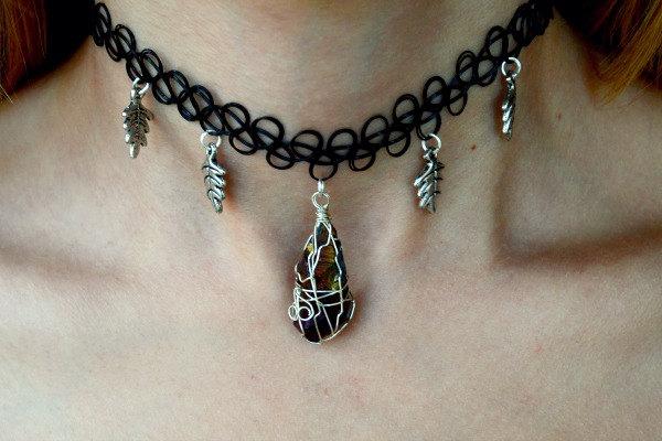 Silver wire wrapped rough orange titanium quartz w/ oak leaves charm