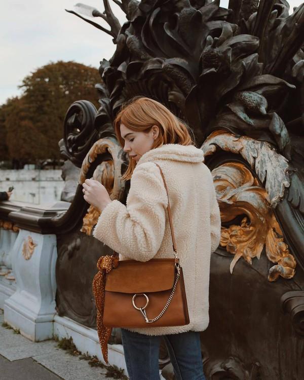 coat neutral coat jeans blue jeans handbag brown handbag bag