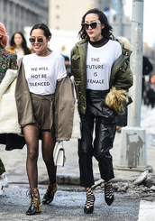t-shirt,nyfw 2017,fashion week 2017,fashion week,streetstyle,quote on it,equality,white t-shirt,jacket,army green jacket,pants,black pants,black leather pants,leather pants,high heels,heels,caged sandals,boots,ankle boots,tights,shorts,blazer,sunglasses,top blogger lifestyle,feminist tshirt
