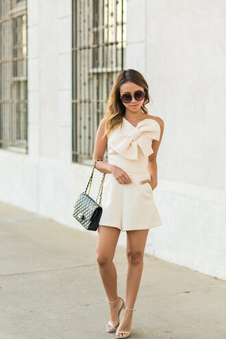 lace and locks blogger romper shoes bag sunglasses white romper one shoulder chanel black bag chanel bag nude sandals round sunglasses bow shoulder bag sandals sandal heels high heel sandals ankle strap heels bachelorette party outfits