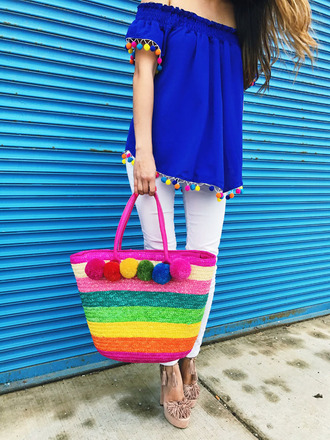 redsolesandredwine blogger top shoes bag sunglasses jewels pants multicolor pom poms blouse blue top white pants spring outfits